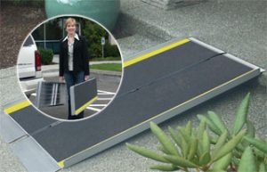 Suitcase ramp for wheelchair or scooter
